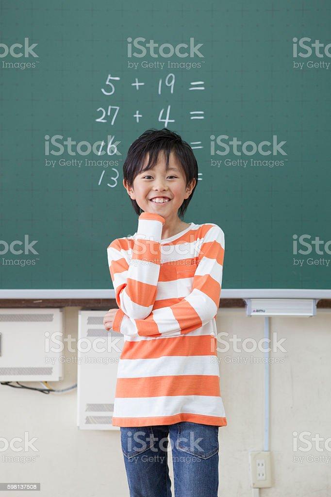 Japanese boy in front of a blackboard stock photo