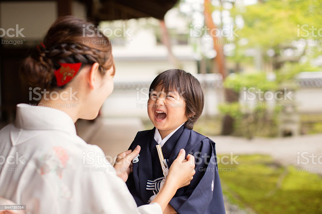 Japanese Boy Laughing with Mother at the Temple Celebrating Shichigosan stock photo