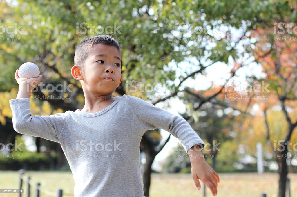 Japanese boy playing catch stock photo