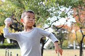 Japanese boy playing catch