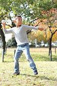 Japanese boy playing catch