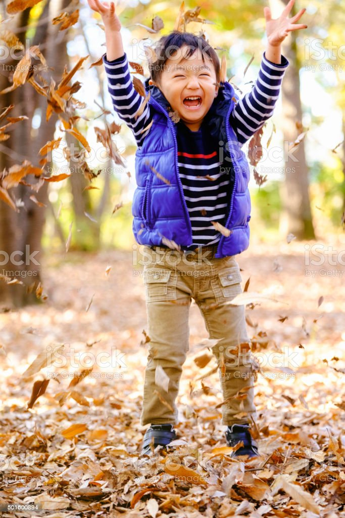 Japanese Boy Playing in a Tokyo Park stock photo