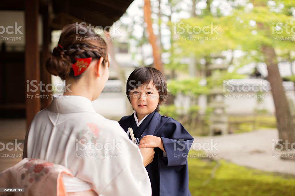 Japanese Boy with Mother at the Temple Celebrating Shichigosan stock photo