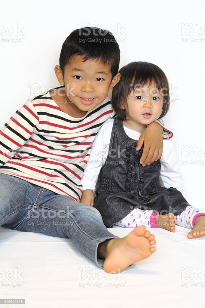 Japanese brother and sister hugging each other stock photo