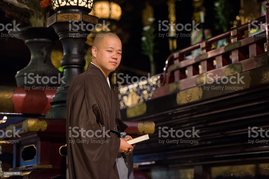 Japanese Buddhist Monk inside of a temple stock photo