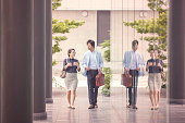 Japanese business colleagues walking near office at kyoto japan