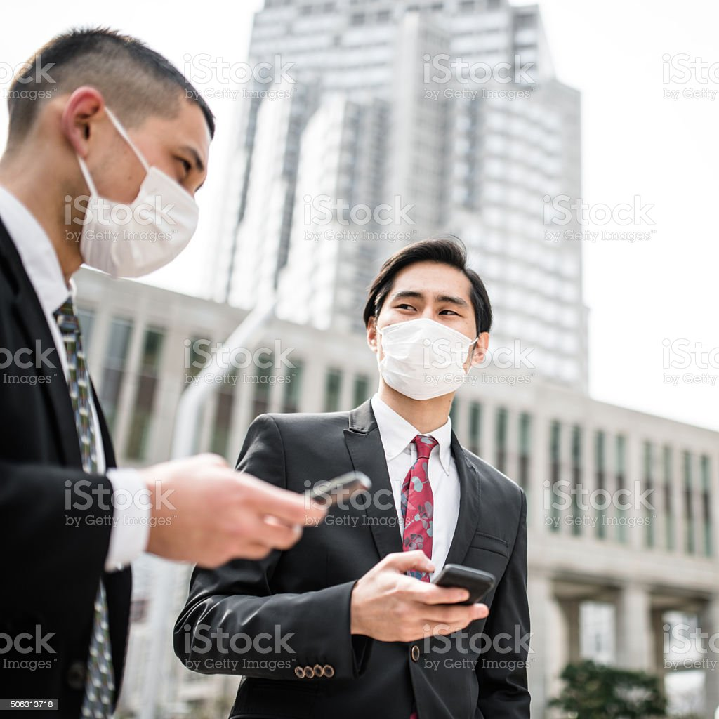 japanese Business man on the phone on the city stock photo
