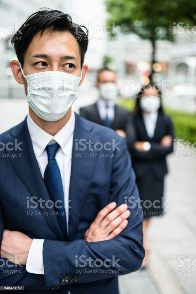 japanese Business man with pollution mask in Tokyo stock photo