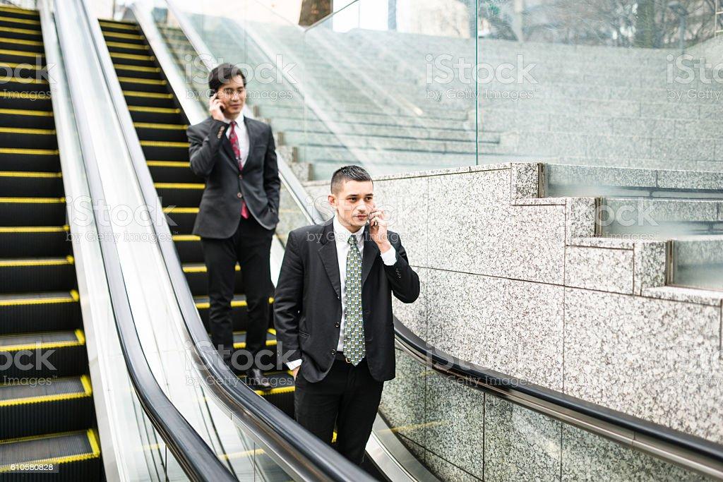 japanese Business on the escalator stock photo