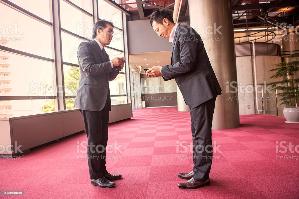 Japanese business partners exchanging businesscard at kyoto japan stock photo