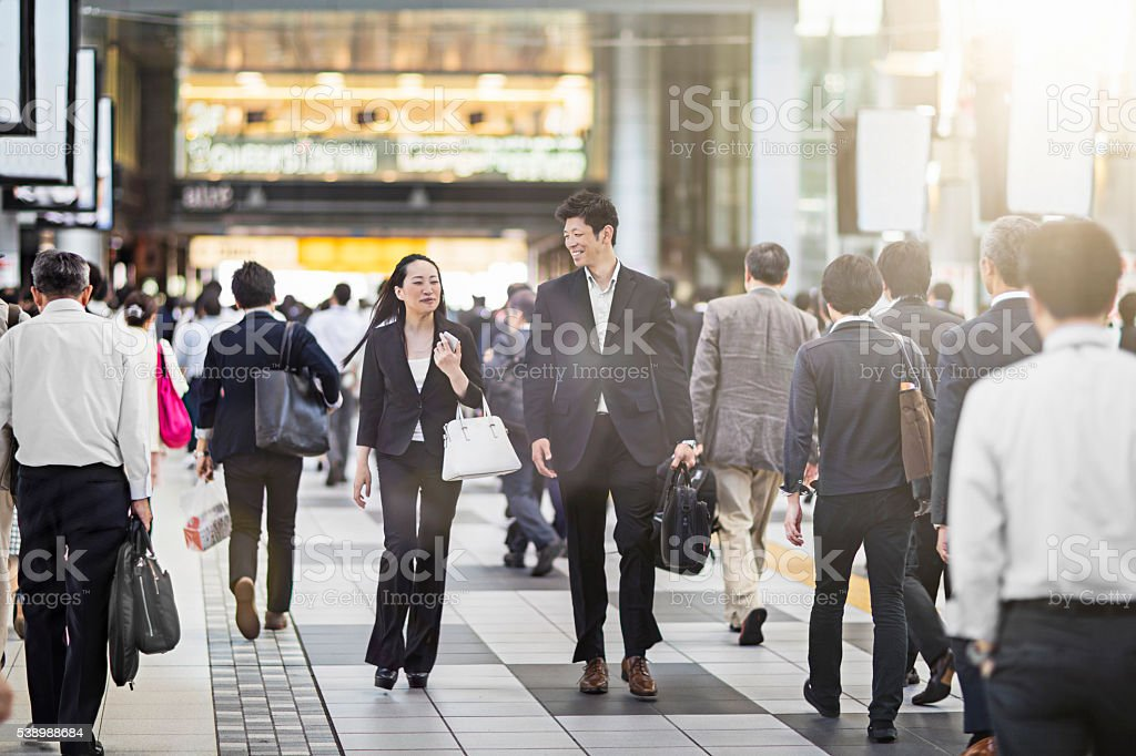 Japanese business people commuting to work at the station stock photo