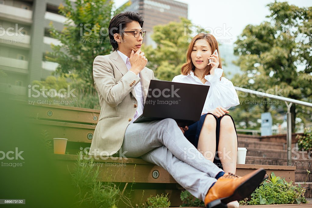 Japanese business people having leisure time outdoors stock photo