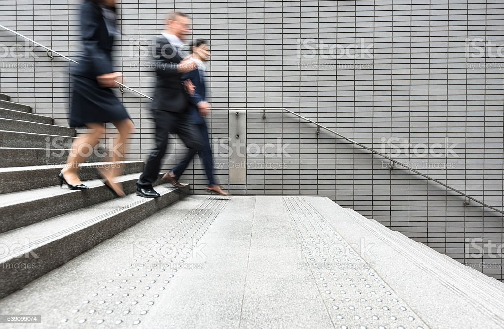 japanese Business running on rush on the city stock photo