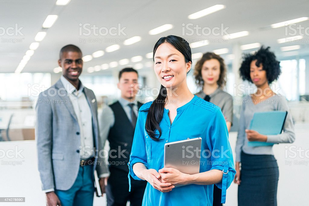 Japanese business woman manager of a multiracial business team stock photo