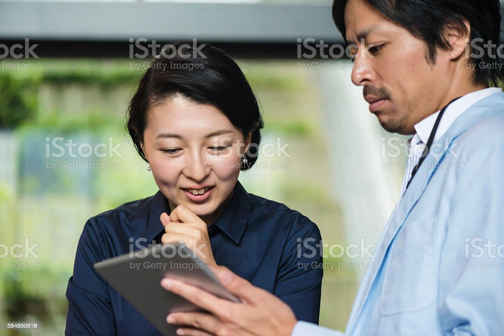 Japanese Businessman and woman stock photo