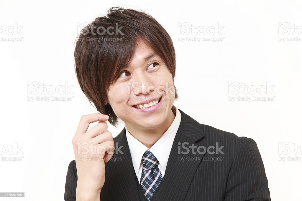Japanese businessman dreaming at his future stock photo