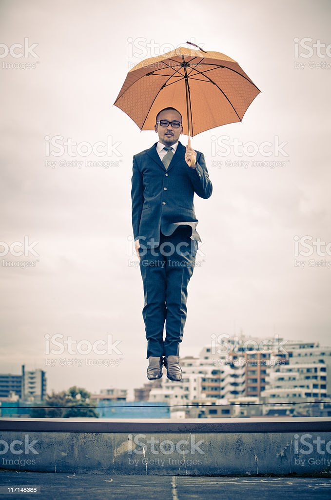 Japanese businessman floating above Tokyo stock photo