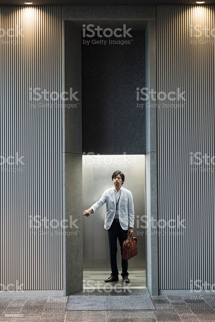 Japanese businessman in modern office lift stock photo
