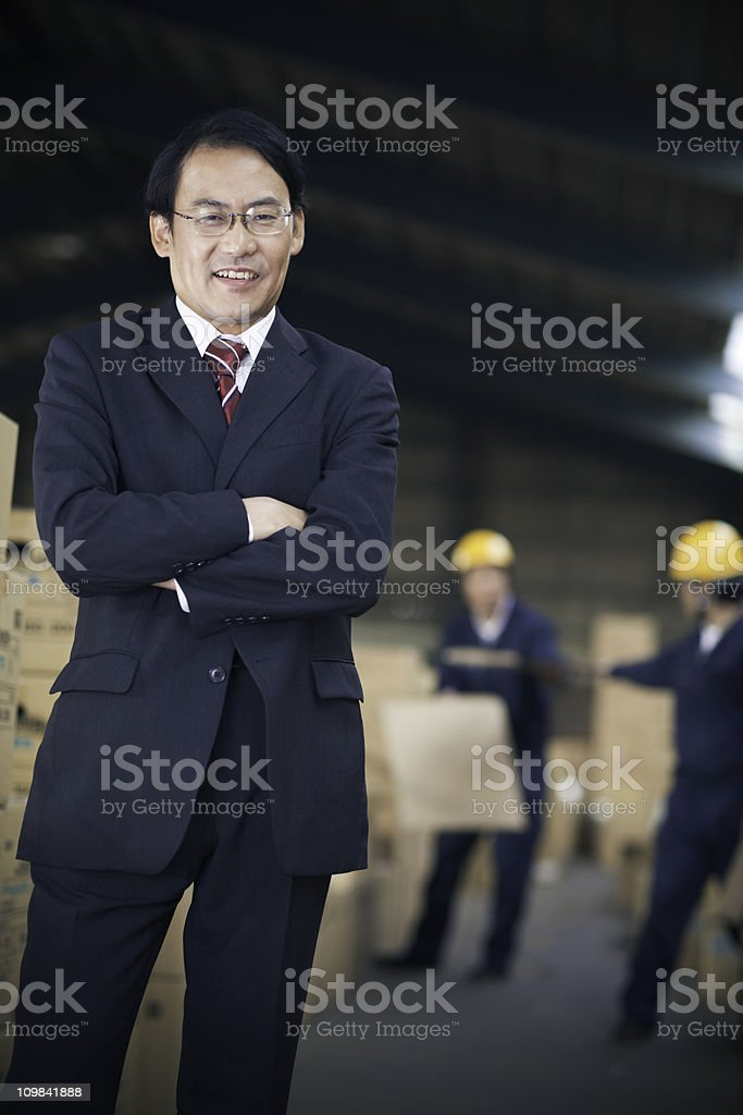 Japanese Businessman in Warehouse royalty-free stock photo