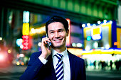 Japanese Businessman on the phone at night Shibuya, Tokyo
