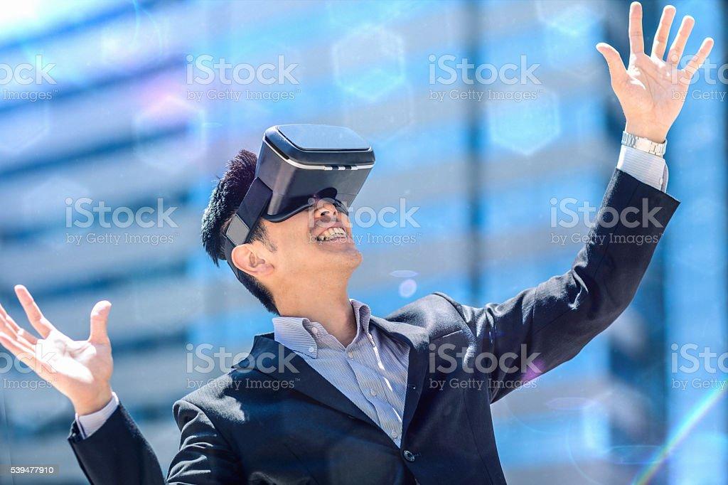 Japanese businessman using the virtual reality headset stock photo