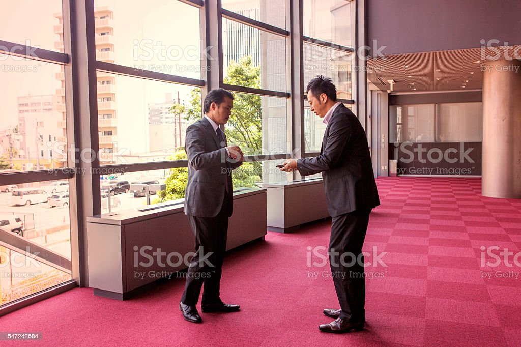 japanese businessmen exchange business card  in office at kyoto japan stock photo