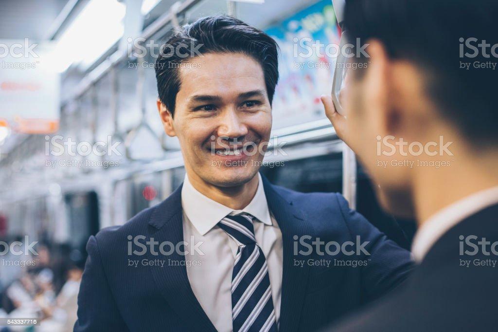 Japanese businessmen in public transportation stock photo