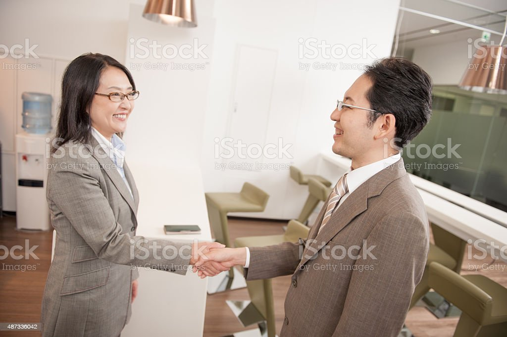 Japanese Businesspeople greating stock photo