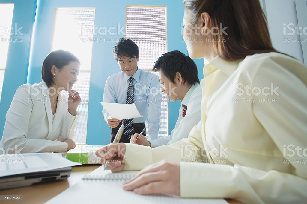 Japanese businesspeople in a meeting stock photo