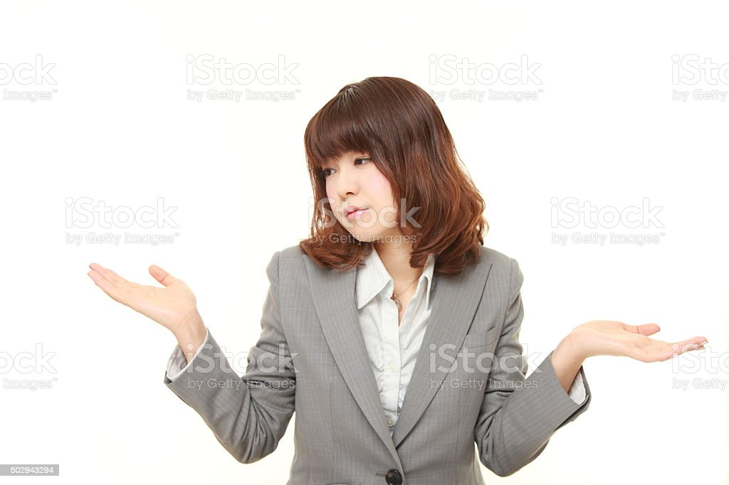 Japanese businesswoman confused stock photo