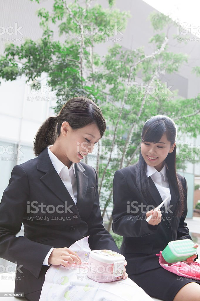 Japanese businesswoman eating outdoors stock photo