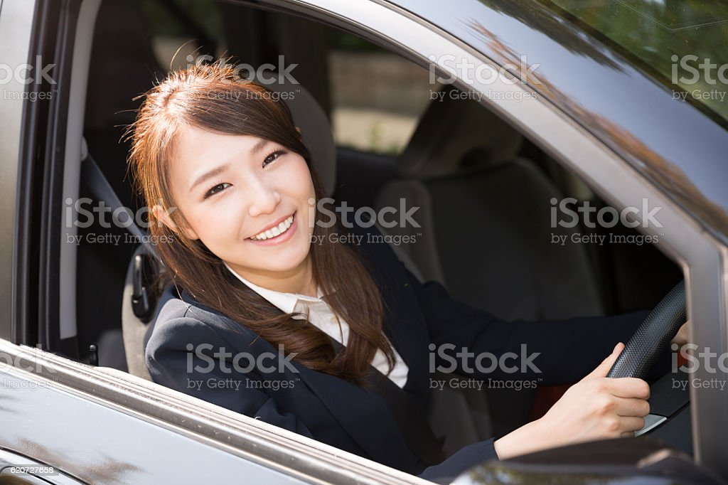 Japanese businesswoman sitting in the car stock photo
