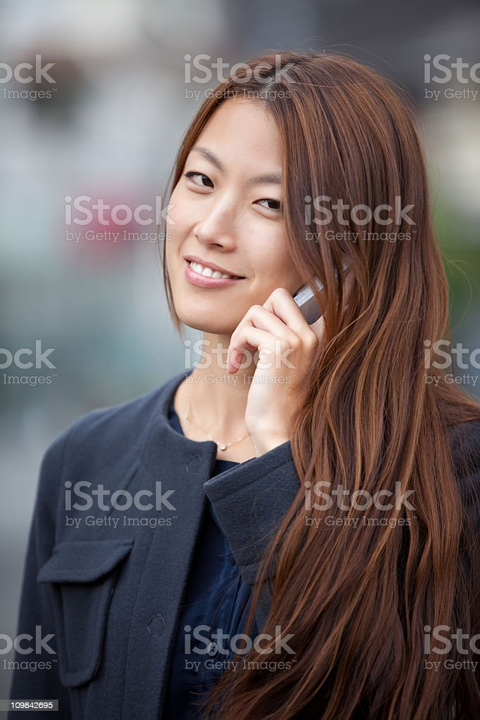 Japanese BusinessWoman talking on the phone royalty-free stock photo