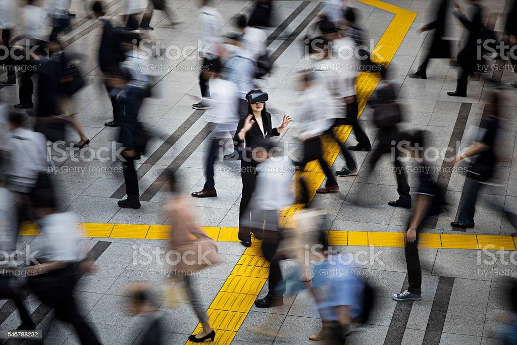 Japanese businesswoman using VR simulator glasses in the street stock photo