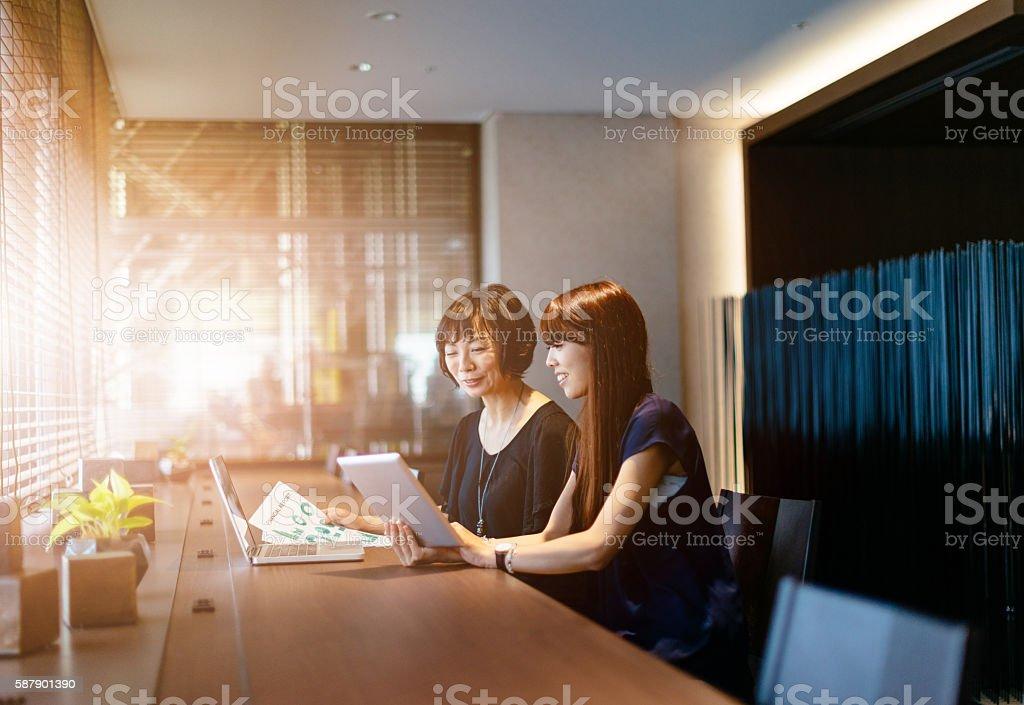 Japanese businesswomen developing business strategy stock photo