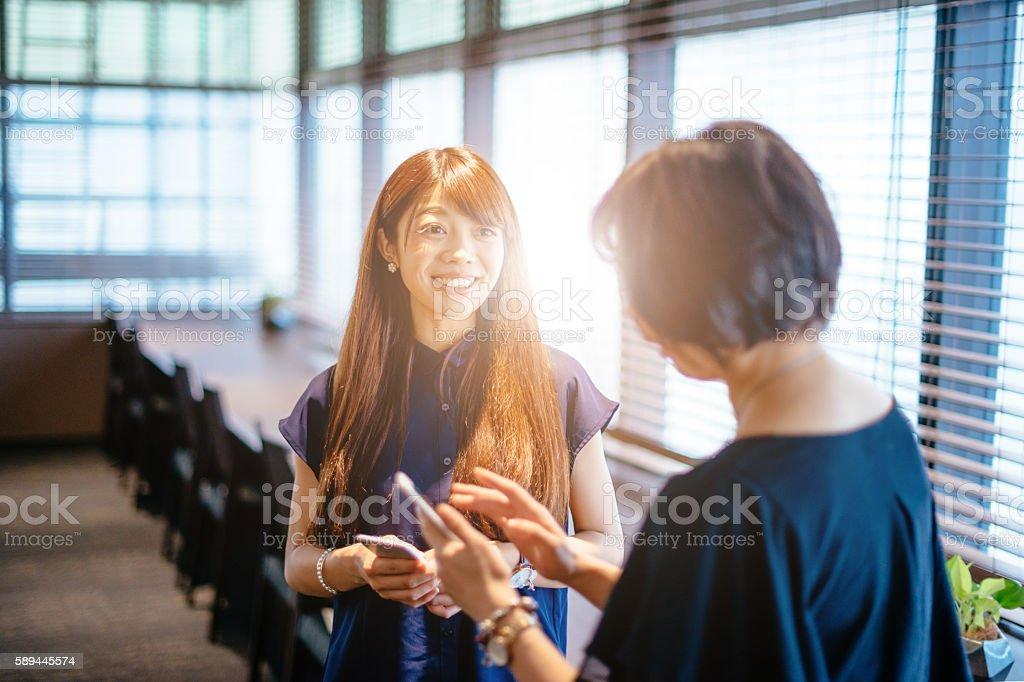 Japanese businesswomen in office stock photo