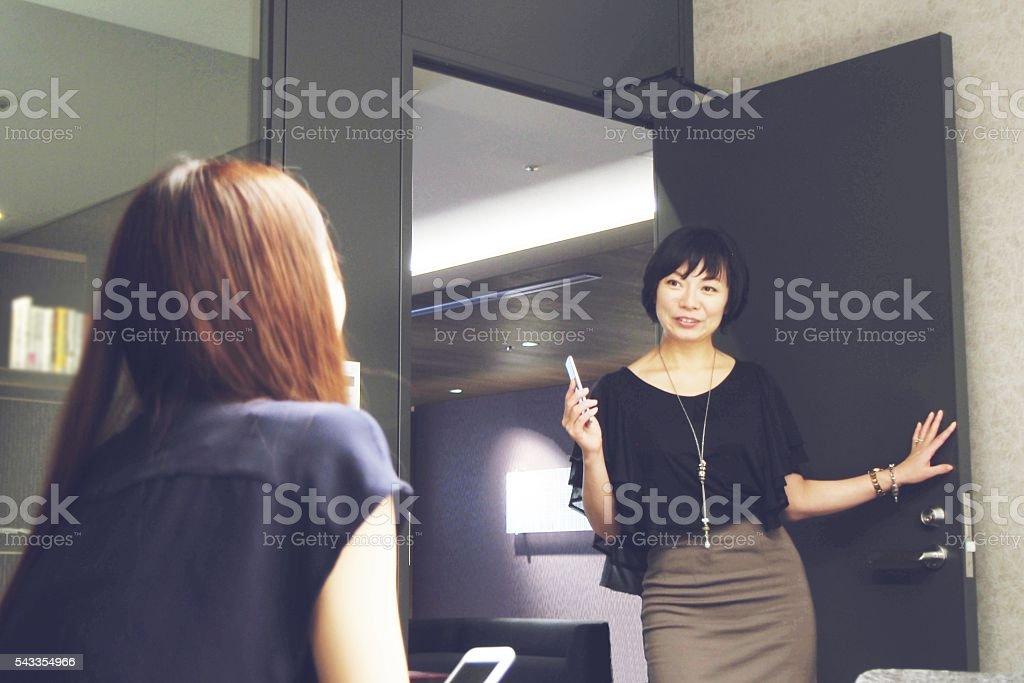 Japanese businesswomen talking stock photo