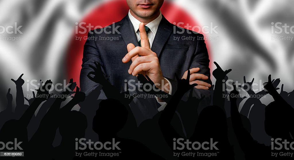 Japanese candidate speaks to the people crowd stock photo