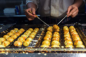 japanese chef cooking takoyaki, tagoyaki is delicious snack in japan.