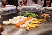 Japanese chef deliberately preparing