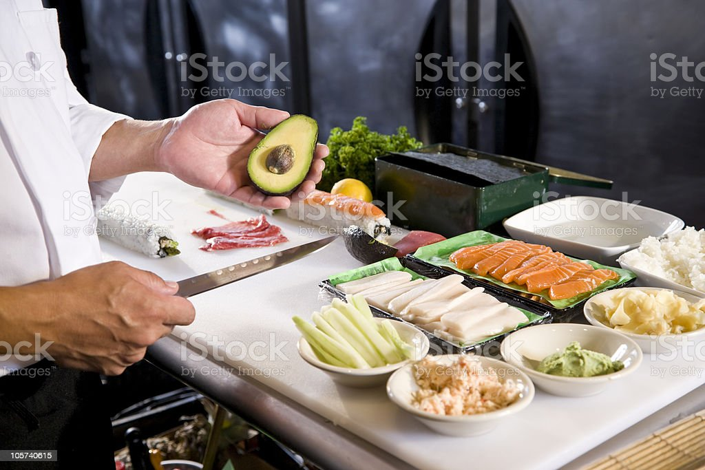 Japanese chef in restaurant with sushi ingredients stock photo
