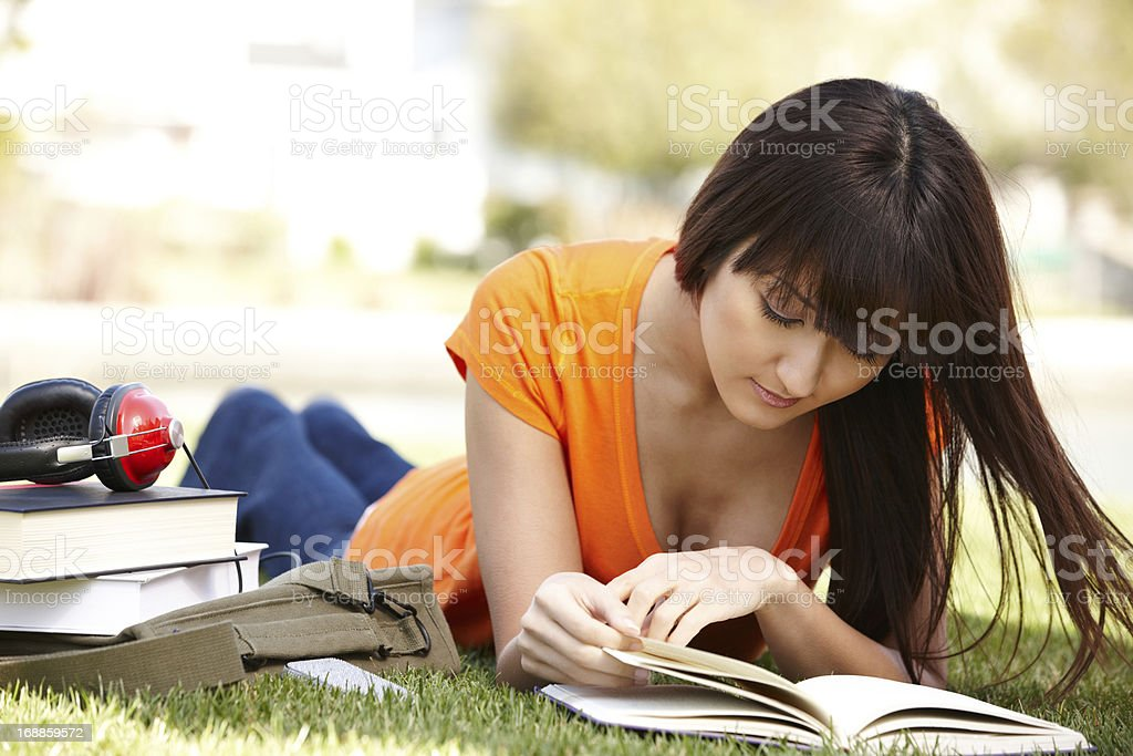 Japanese college student studying outdoors royalty-free stock photo