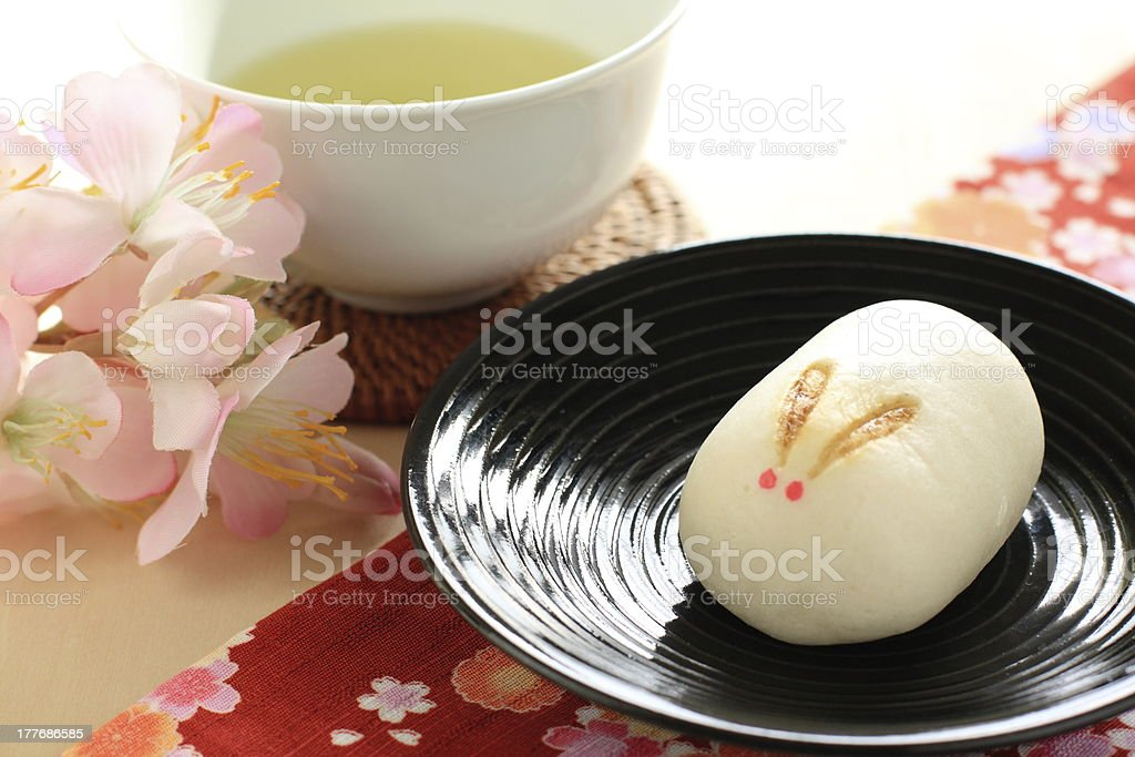 japanese confectionery, manju on dish with green tea royalty-free stock photo