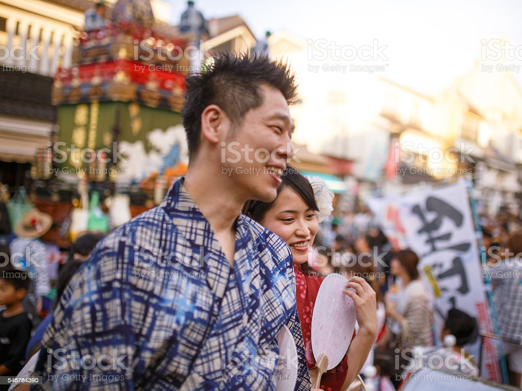 Japanese couple dating at Matsuri, wearing yukata stock photo