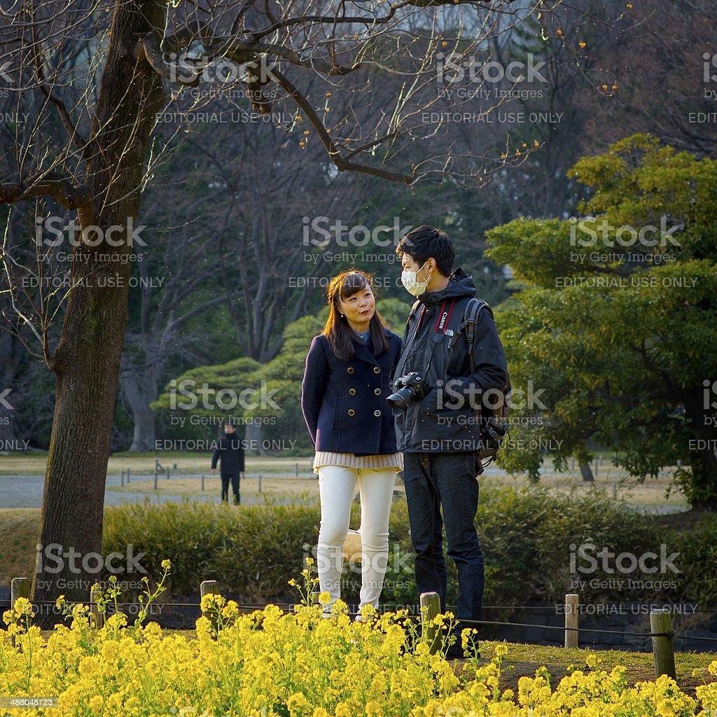 Japanese couple in a Tokyo garden stock photo