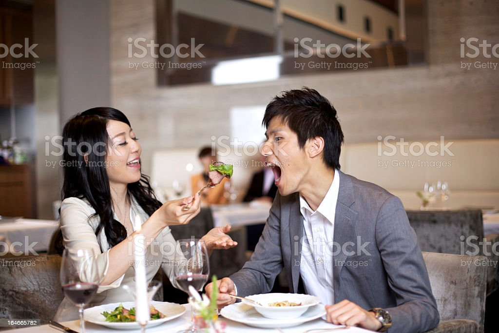 Japanese Couple Playful Eating royalty-free stock photo