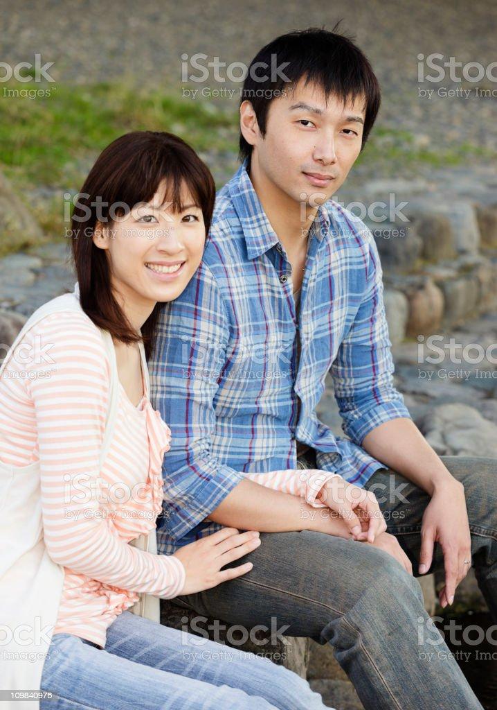 Japanese Couple Sitting Outdoors royalty-free stock photo
