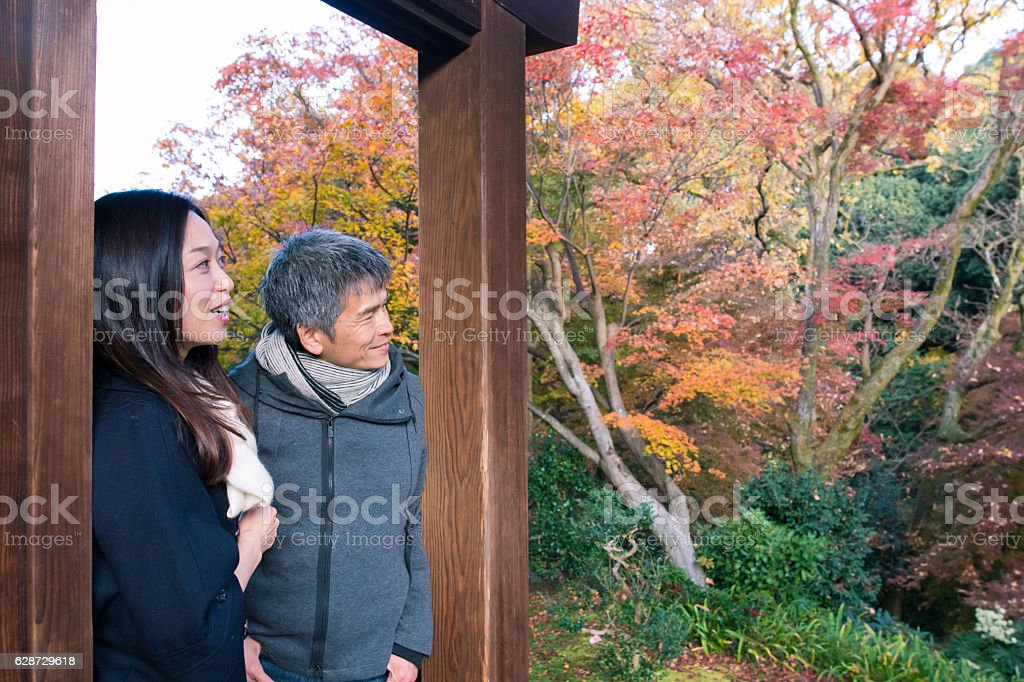 Japanese couple traveling to enjoy autumn scenery stock photo