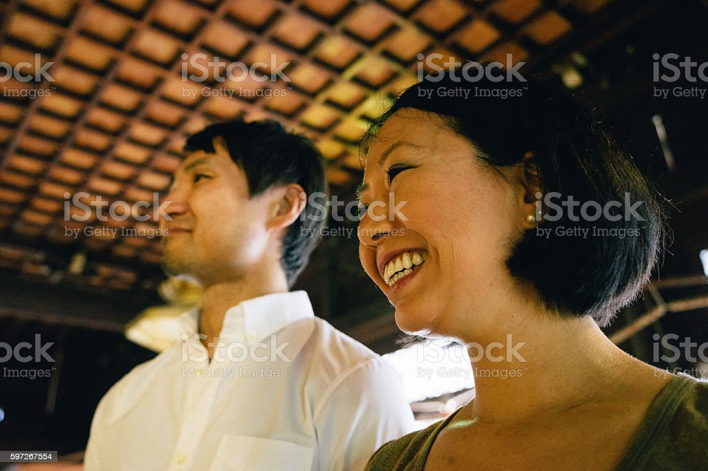 Japanese couple visiting a buddhist temple stock photo