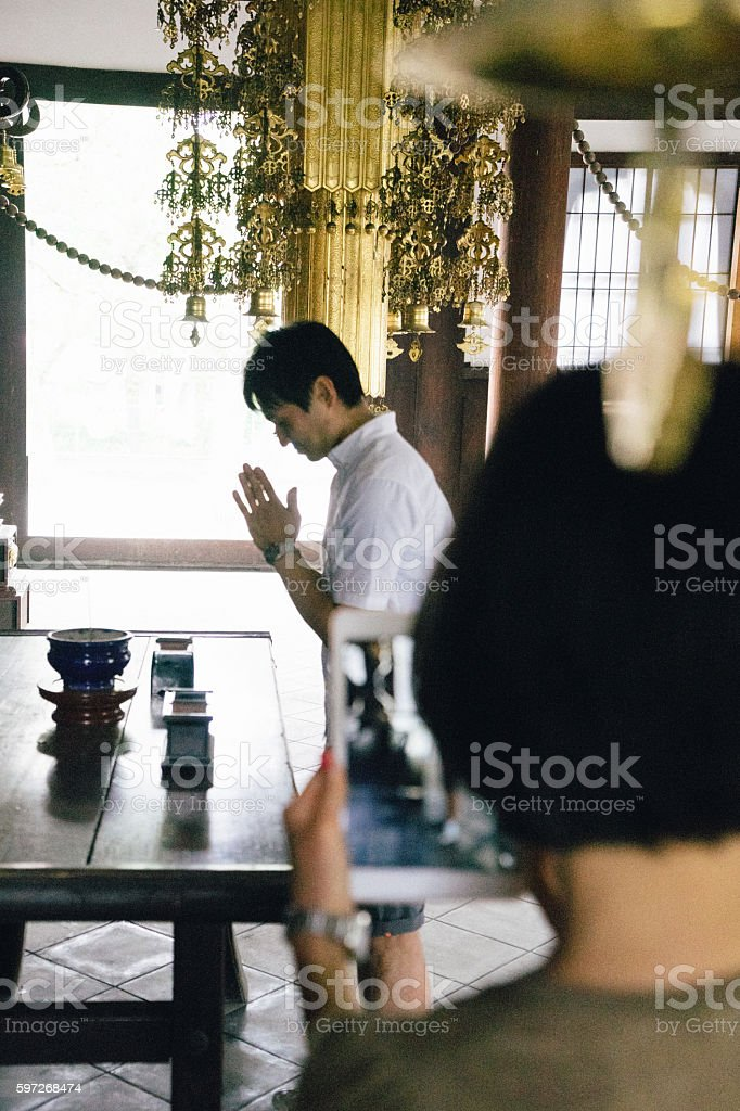 Japanese couple visiting a buddhist temple taking a memory picture stock photo